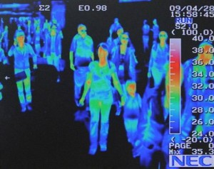 A thermally imaged photo of a small crowd.